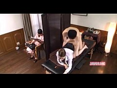 Husband gets massage next to wife