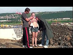Cute petite girl is fucked in public construction site by 2 guys with big dicks