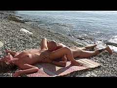 Outdoors sex. Mutual oral sex of a amateur nudist couple on the beach