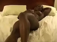 Ebony Bodybuilder Playing On Bed
