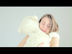 Hot naked blonde cuddling her teddy bear