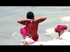 Indian woman bathing in ganges river backless open