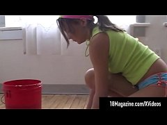 Cute Cleaning Teen, Andi Pink gets on her hands & knees to clean the floor & removes her clothes so she can do a better job. More of Andi Pink & almost 1000 models at 18Magazine.com!