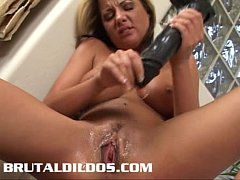 Sophia taking a big long black brutal dildo in her mouth and pussy
