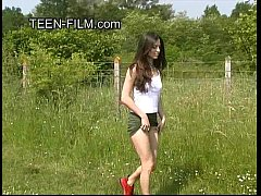 brunette teen pissing in forest