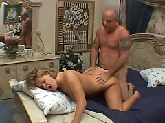 Horny slut masturbates on her big bed