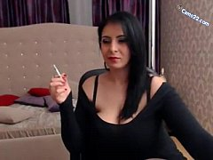 Brunette milf smoking cig and showing huge bobs on cams22.com
