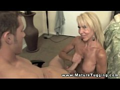 Mature busty blonde tit wanks young guy