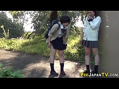 Asian teens pee outside