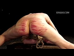 Bound slave girl shaking with pain
