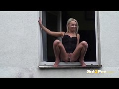 pee in public - hot babe sits in the window and pisses outside for everyone to see