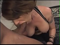 Gorgeous babe with stunning tits gives a blowjob