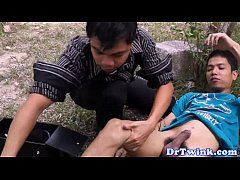Asian doctor sucks twins cock outdoors