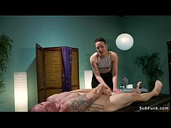 Short haired brunette masseuse dominatrix Lilith Luxe ties up male client and then spanks his ass