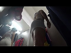 Peeping in a public fitting room. Juicy ass in panties and long legs fell into the lens of a hidden camera. Fetish.