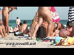naomi1 handjob a young guy on a public beach