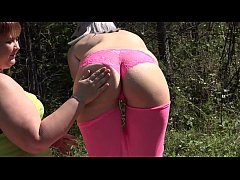 Two lesbians with big asses outdoors use a new sex toy and masturbate with it to orgasm with a squirt.