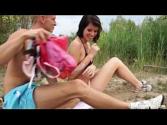 Busty cutie fucks a blonde guy outdoors