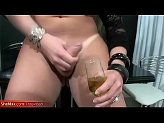 Busty feminine tranny cumshots into a glass and drinks it up