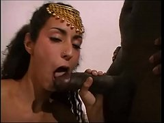 Arabian dancer handles and sucks two cocks