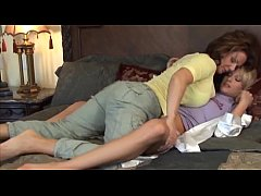 mature woman having lesbian sex with a young woman who visits her house