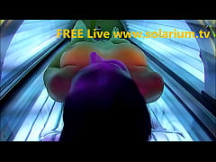 Solarium Beautiful girl with big breasts masturbates under the solarium