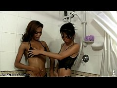 Two ladyboy girlfriends pull each others cocks in the shower