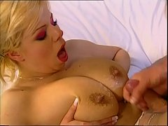 Blonde milf sucks a cock who's about to squirt on her big boobs!