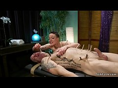 dominant masseuse lilith luxe in black tights massages male slave in rope bondage