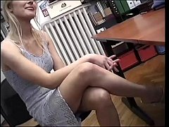 She watches a sex tape jerking off her pussy