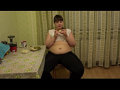 Sexy bbw eats in the kitchen and strokes fat belly. Fetish.