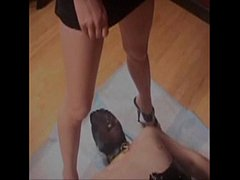 Sexy Femdom mistress pees on slave's mout ...