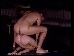 Young blonde hottie Sandy Balestra enjoys licking Rocco Siffredi's toes while he polish her tight arse with his massive tool at the strip joint