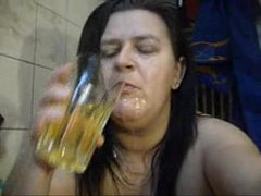 BBW PISS IN CUP AND POURS ON FACE -