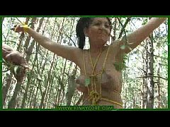Bound young girl tortured with nettle in the forest
