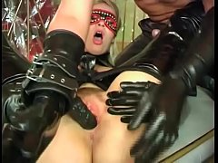 An unleashed slut in fetish dress ass fucked by a filth and aroused masked man