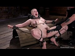 Trimmed hair blonde in metal device bondage gets feet paddled
