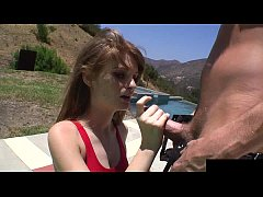 This tall redheaded lifeguard is showing her knockers and fucking her boyfriend