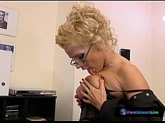 Ginger Jones in a sexy black outfit digging her cunt using dildo
