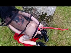 Blasphemic satanic gothic whore fucking her pussy and ass in an old cemetary