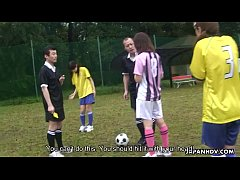 Asian soccer player gets a yellow card and a cock