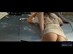 American lesbian girls fingering on the hood of a Corvette