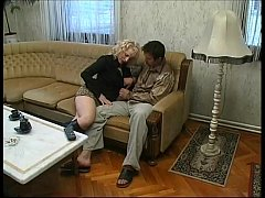 sexy blonde in black boots seduces a distracted man watching tv
