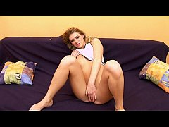 Young chick gets pleasure on the sofa