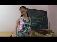 Young schoolgirl plays with herself in classrom