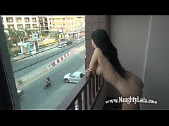 Nude in public on the balcony overlooking road.