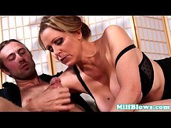 Classy milf sucking and tugging veiny cock