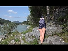Without panties under a skirt in nature. And a walk in a swimsuit outdoors. Fetish with spying for the big ass.