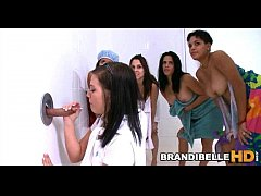 Brandi Belle's Friends Watch Her Suck Cock Through Gloryhole