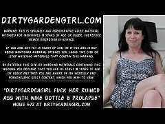 Dirtygardengirl fucking her ruined ass with two wine bottles big and bigger. Then prolapse